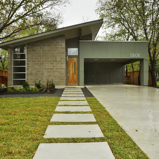 Стильный дизайн: маленький, одноэтажный бетонный фасад в стиле ретро - последний тренд