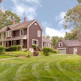 Large cottage brown three-story wood house exterior idea in Boston
