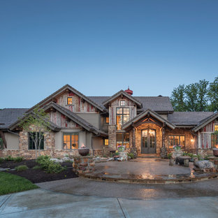 Mountain style brown two-story mixed siding exterior home photo in Kansas City with a tile roof