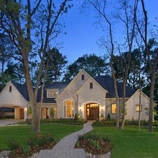 Elegant stone exterior home photo in Houston