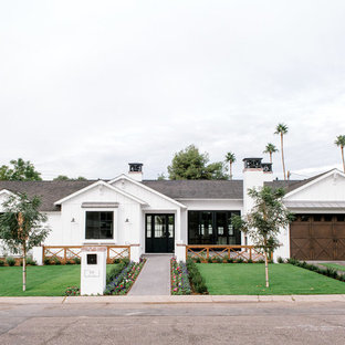 Farmhouse white one-story gable roof idea in Phoenix with a shingle roof