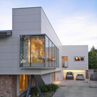 Inspiration for a contemporary two-story mixed siding exterior home remodel in Houston