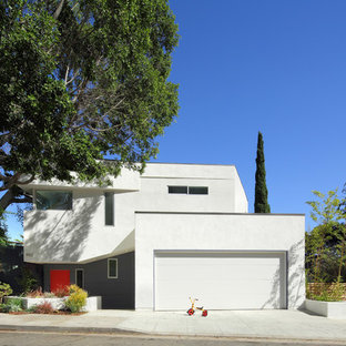 Modern white two-story flat roof idea in Los Angeles