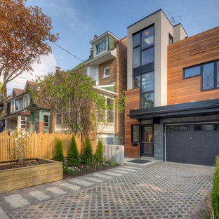Design ideas for a contemporary exterior in Toronto with wood siding.
