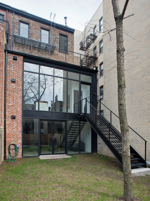 Inspiration For A Large Transitional Three Story Brick Townhouse Exterior  Remodel In New York