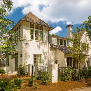 Large elegant white three-story brick house exterior photo in Other with a gambrel roof and a shingle roof