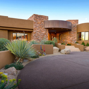 Huge southwestern brown one-story stucco exterior home idea in Phoenix