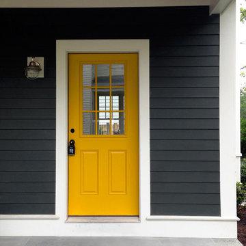A door color to pop dark gray siding!