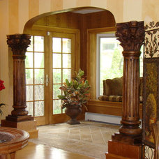 Mediterranean Family Room by Home Restoration Services, Inc.
