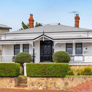 Photo of a traditional one-storey brick white house exterior in Perth with a metal roof and a hip roof.