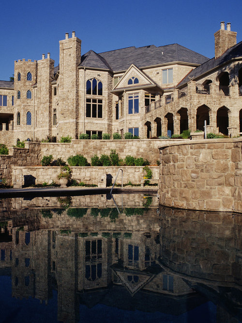 Example Of A Huge Tuscan Beige Three Story Stone Exterior Home Design In  Cedar Rapids