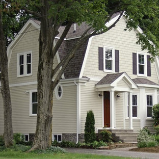 Small victorian beige two-story concrete fiberboard exterior home idea in Boston with a gambrel roof