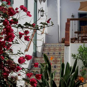 A Santa Barbara Spanish Revival outdoor staircase with decorative tiles.