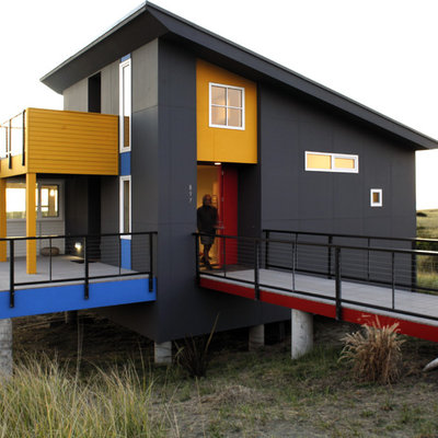 Inspiration for a small contemporary one-story exterior home remodel in Seattle with a shed roof