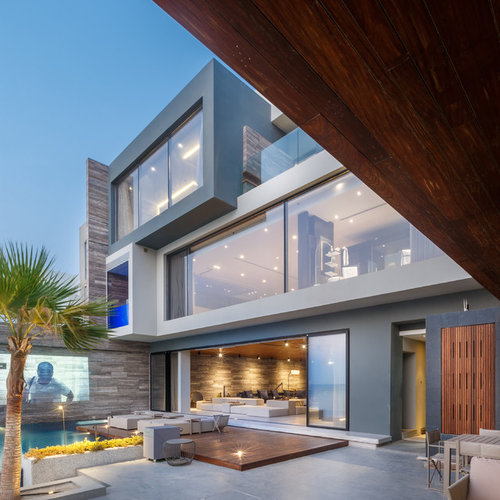 exterior house design. Example of a trendy gray three story stucco flat roof design in Hyderabad Contemporary Exterior Home Ideas  Design Photos Houzz
