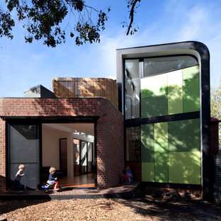 Inspiration for a medium sized contemporary two floor house exterior in Melbourne with mixed cladding.
