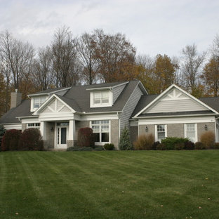 Mid-sized arts and crafts gray two-story mixed siding house exterior photo in New York with a gambrel roof and a shingle roof