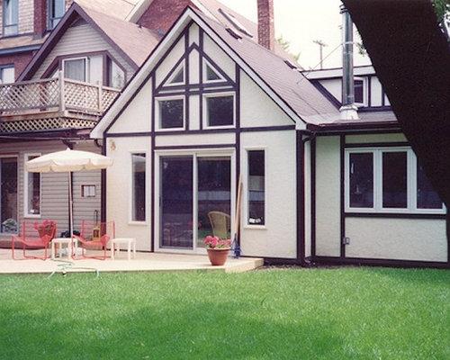 Eclectic exterior design ideas renovations photos for Piani di casa cottage con porte cochere