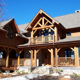 Large mountain style brown three-story wood exterior home photo in Atlanta with a shingle roof