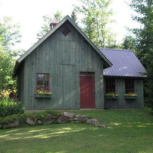 Example of a country exterior home design in Burlington