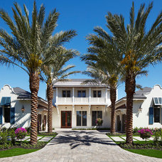 Tropical Exterior by Turtle Beach Construction & Remodeling