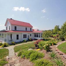 Farmhouse Exterior by Smith & Robertson, Inc.
