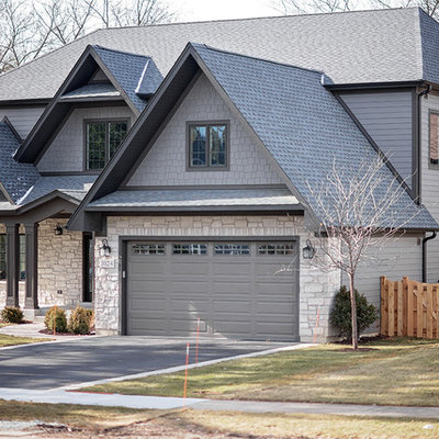 Large traditional gray two-story concrete fiberboard exterior home idea in Chicago with a shingle roof