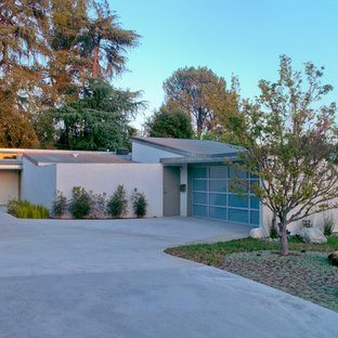 Small 1960s white one-story stucco exterior home photo in Los Angeles