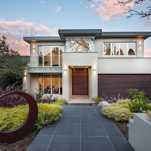 Inspiration for a contemporary two-storey beige house exterior in Sydney with a flat roof.