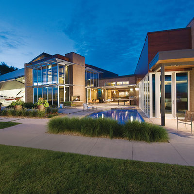Huge contemporary two-story exterior home idea in Denver