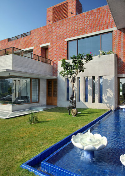 Contemporary Exterior by Dipen Gada and Associates