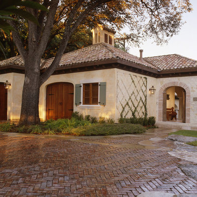 Inspiration for a mid-sized mediterranean beige two-story stone exterior home remodel in Austin with a shingle roof