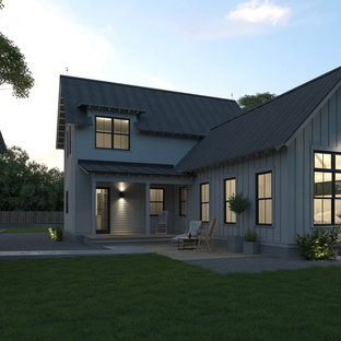 Inspiration for a small cottage white two-story vinyl exterior home remodel in Austin with a metal roof