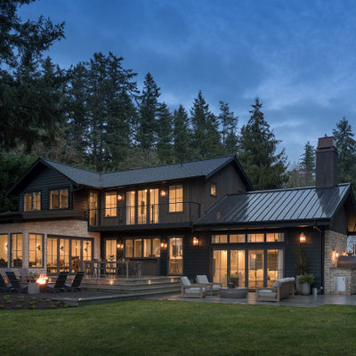 Country multicolored two-story mixed siding exterior home idea in Seattle with a shingle roof