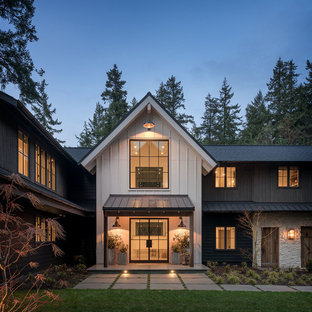 Farmhouse multicolored two-story mixed siding exterior home photo in Seattle with a shingle roof