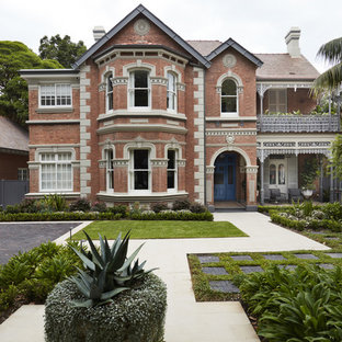 Inspiration for a large traditional two-storey brick grey house exterior in Sydney with a gable roof and a tile roof.