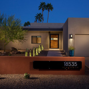 Southwestern brown one-story exterior home idea in Phoenix