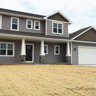 Inspiration For A Mid Sized Contemporary Gray Two Story Vinyl Gable Roof Remodel In
