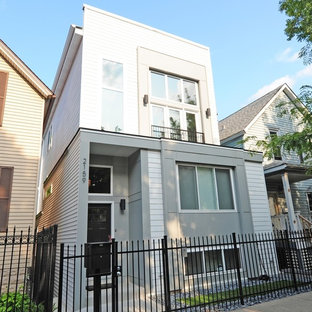 Example of a mid-sized minimalist gray two-story mixed siding exterior home design in Chicago with a metal roof