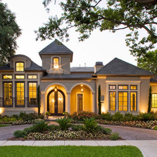 Inspiration for a mediterranean two-story exterior home remodel in Dallas