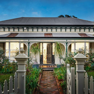 Design ideas for a victorian one-storey white house exterior in Melbourne with a hip roof and a metal roof.