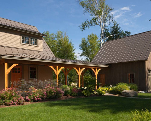 Inspiration For A Timeless Brown Two Story Exterior Home Remodel In  Burlington With A Metal