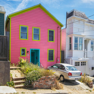 Mid-sized eclectic pink three-story wood exterior home idea in San Francisco with a shingle roof