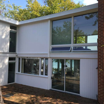 Andersen A series awning windows, picture windows and patio doors.