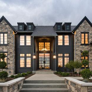 На фото: двухэтажный, черный частный загородный дом в стиле современная классика с комбинированной облицовкой, двускатной крышей и крышей из гибкой черепицы с