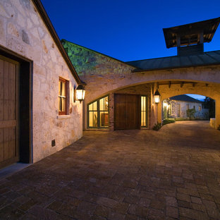 Inspiration for a rustic brick exterior home remodel in Austin