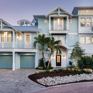 Beach style blue two-story mixed siding exterior home photo in Tampa with a metal roof