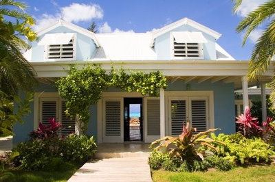 Bahama shutters bring the look of the tropics home for Stile key west