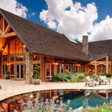 Rustic Exterior by Moon Bros Inc