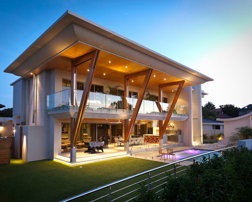 exterior house designer. this is an example of expansive contemporary two-storey beige exterior in perth with house designer